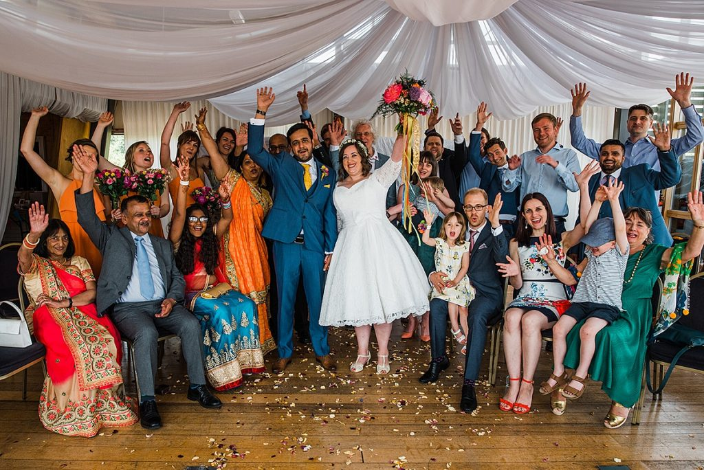 group photograph of all guests at a cultural fusion wedding