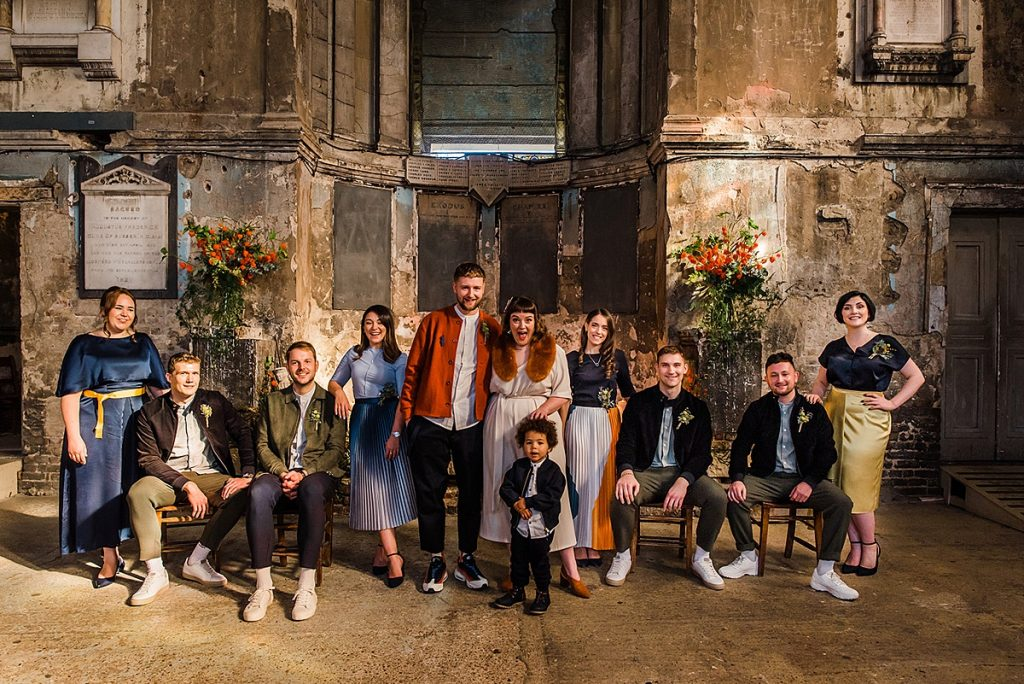 Wedding party gathers for family group photo at the asylum in London
