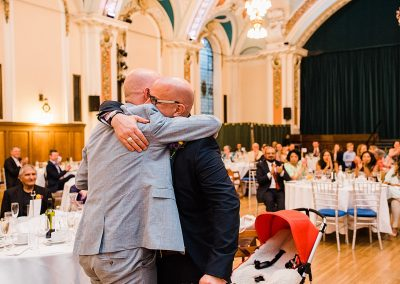 groom and brother hug during emotional wedding speech