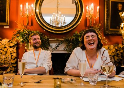 bride and groom laugh during wedding speech at Brunswick House Wedding