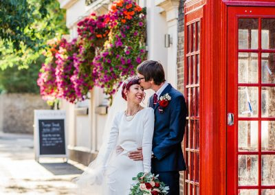 Couple portrait by red phone box Islington Wedding