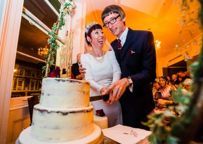 Bride and groom cutting cake at Canonbury Tavern Islington Wedding