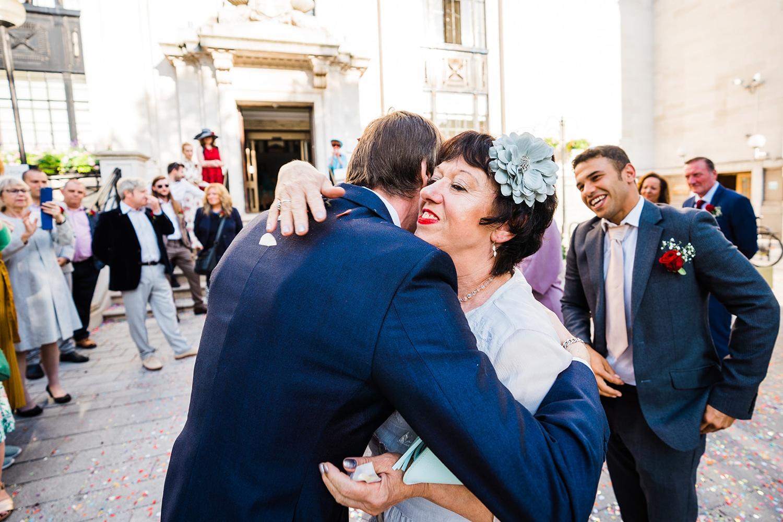 Groom hugging son Islington Wedding