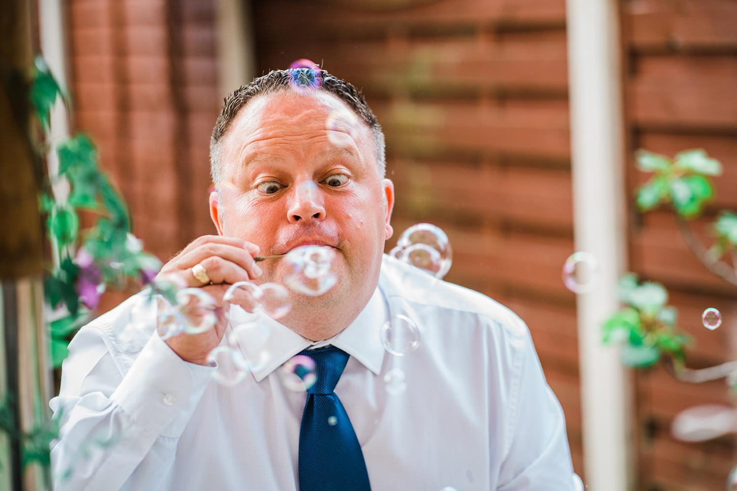 Wedding guest blowing bubbles small wedding