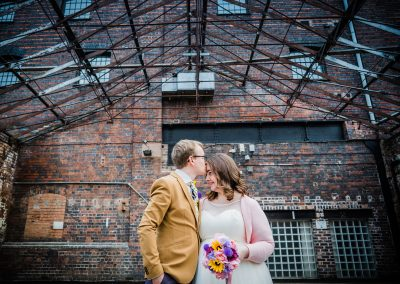 Bride and groom under factory roof industrial Digbeth The Bond Company Birmingham Wedding