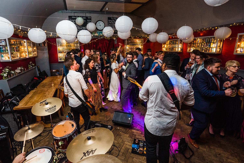 A dancefloor full of guests at a Londesborough pub wedding