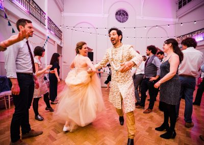 Bride-and-groom-dance-ceildh-at-tab-centre-wedding