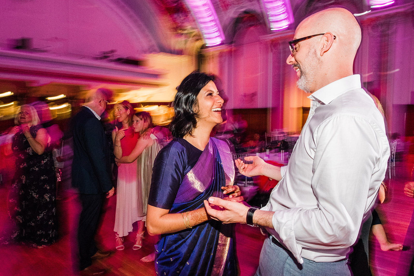 bride-in-pink-and-purple-wedding-sari-dances-with-groom-at-stockport-town-hall-wedding-party