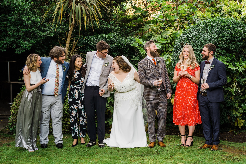 Bride and groom with wedding party Fredericks Islington Wedding Photography