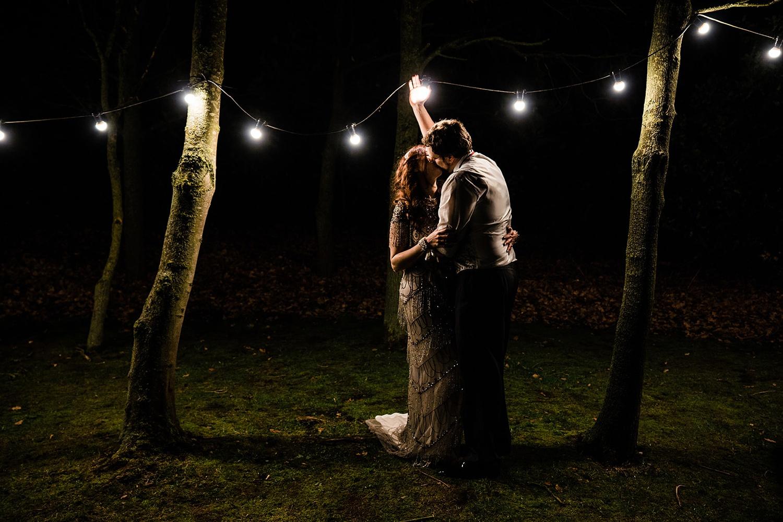 bride and groom under lights Shustoke Barn wedding