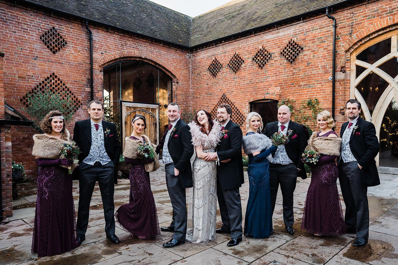 Informal group shot of bridal party at Shustoke Barn wedding