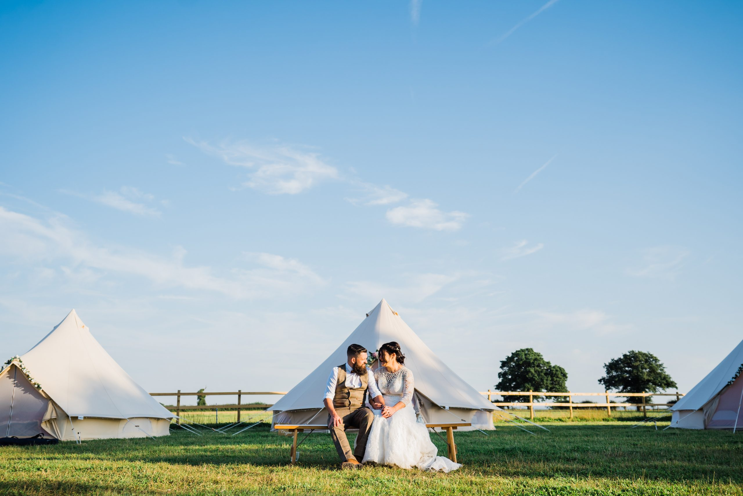 Bride and groom in front of bell tents Kingstanding-Farm-Wedding