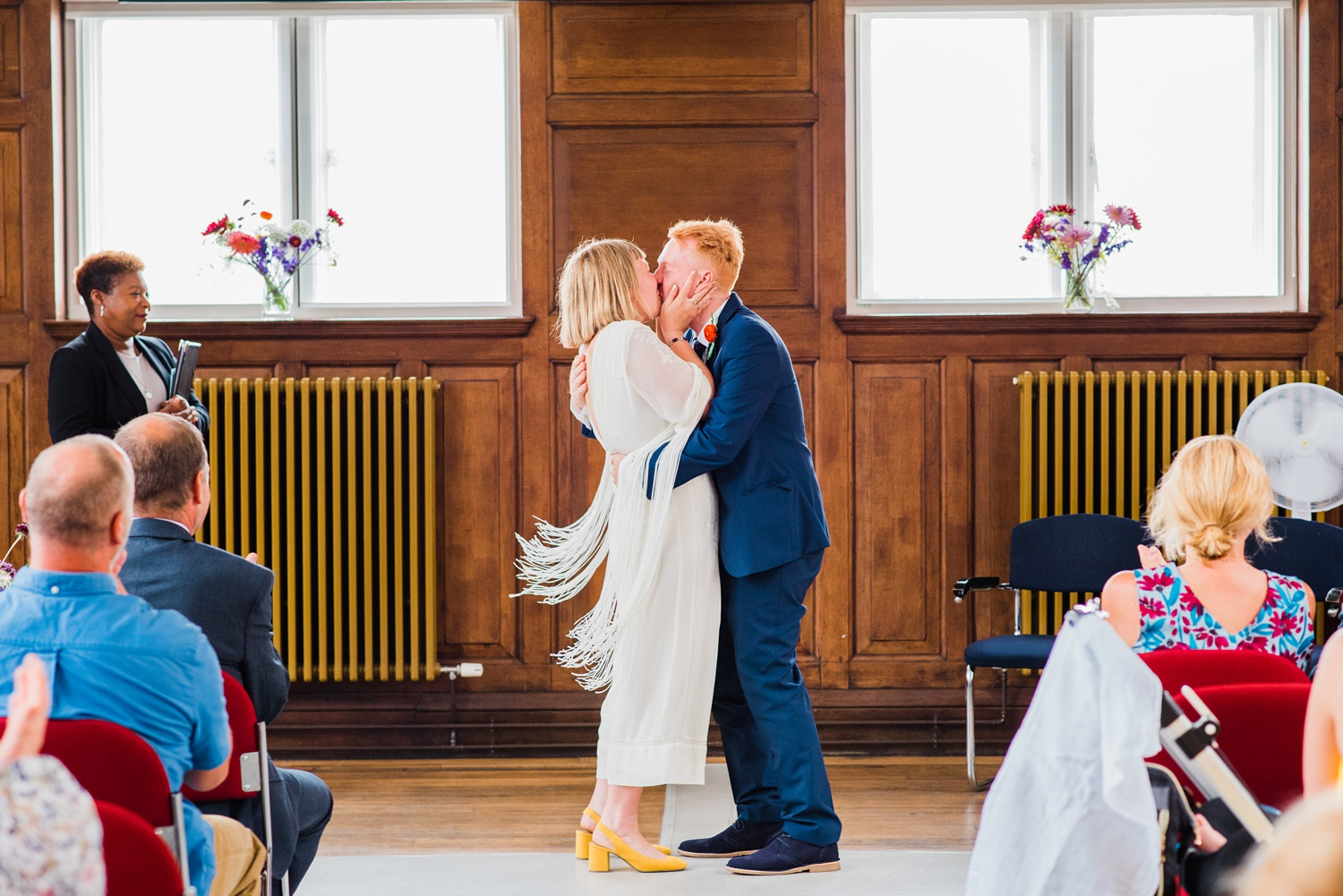 Bride and groom kissing Peckham Employment Academy Wedding