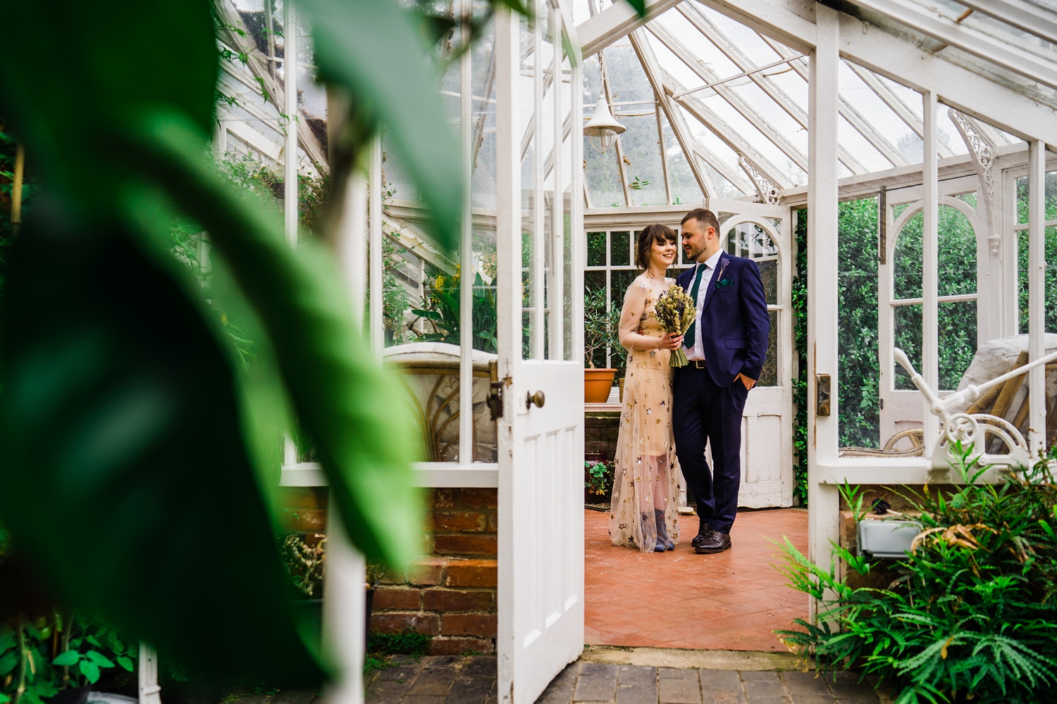 Couple in glasshouse Yeldersley-Hall-Wedding