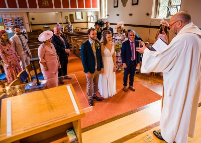 Vicar proniunces bride and groom married at socially distanced wedding