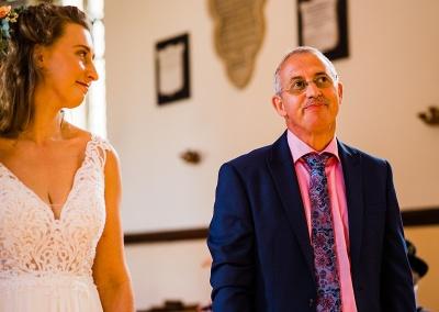 Father gives bride away at a socially distanced wedding.