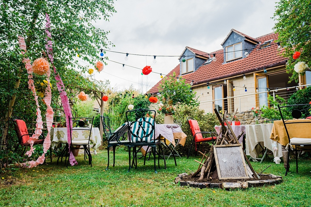 home garden decorated for socially distanced wedding reception at home.